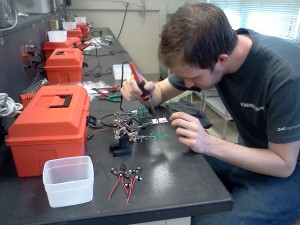 soldering at workbench